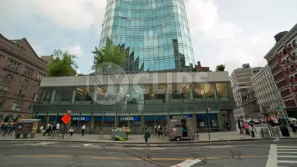 Chase Bank in Cooper Square on summer day with people walking on sidewalk in Manhattan NYC