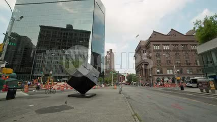 360 degree view of Cooper Square - panning famous cube sculpture and people walking on summer day