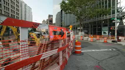 construction site detour directions arrow and orange cones in Cooper Square in Manhattan NYC
