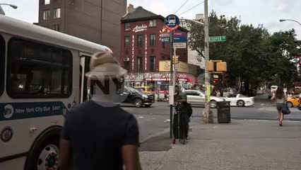 bus doors closing at Cooper Square in East Village on summer day in Manhattan NYC