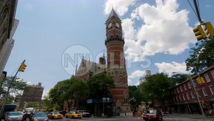 wide shot of Jefferson Market Library clock tower in Greenwich Village - 4K timelapse in Manhattan NYC