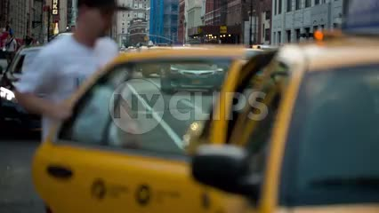 two men getting into taxi cab on Lafayette Street in Cooper Square Manhattan NYC