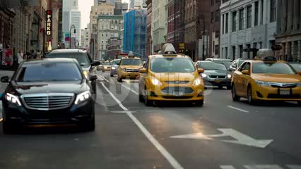Taxis driving down Lafayette Street in early evening traffic - downtown Manhattan in NYC